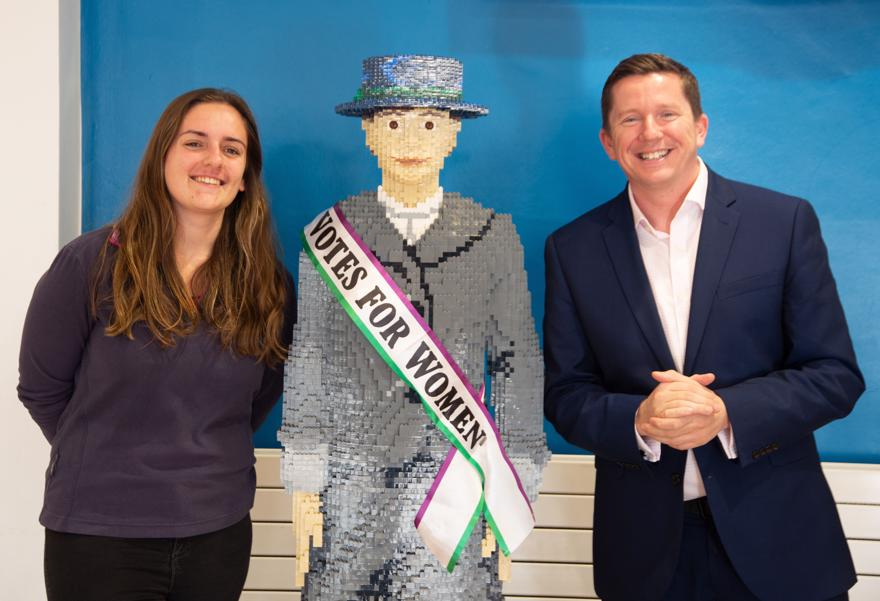 Ross Renton and Meghan from the student's Union with the lego suffragette