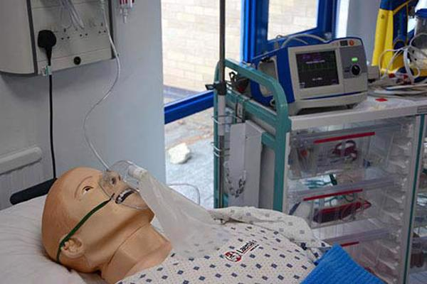 Sim man dummies lying in hospital bed in one of our nursing degree clinical skills rooms.