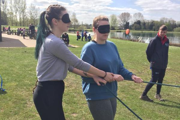 A group of student occupational therapists are performing a team building activity while blindfolded as part of our occupational therapy degree.
