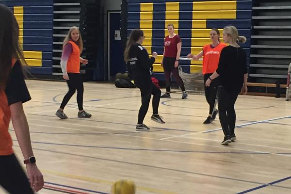 A group of female trainee occupational therapists playing football as part of our occupational therapy degree.