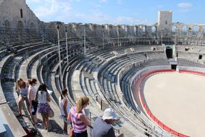 students on the steps of a circular stadium