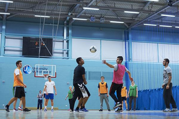 men playing handball in a gym