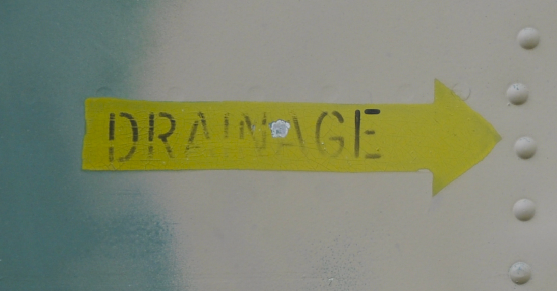 A photograph of an arrow pointing to drainage