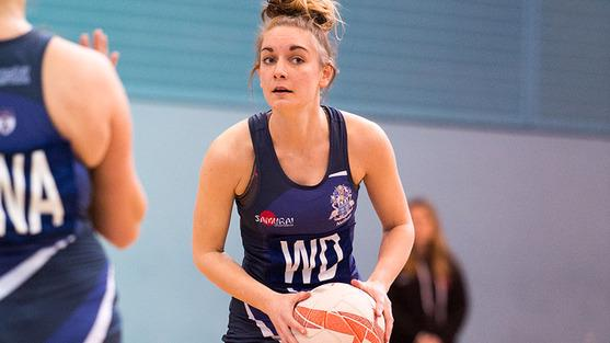 A University of Worcester netball player holds a ball