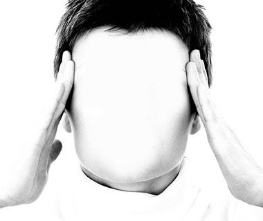A faceless person is holding their head to indicate that they are stressed.