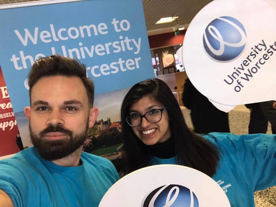 University of Worcester students greet international students at the airport