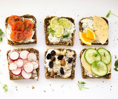 Six pieces of toast are covered with healthy vegetable toppings