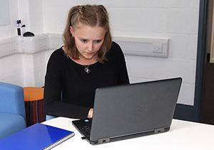 Female student working at a computer