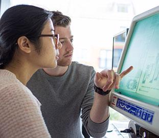 two students at a computer screen