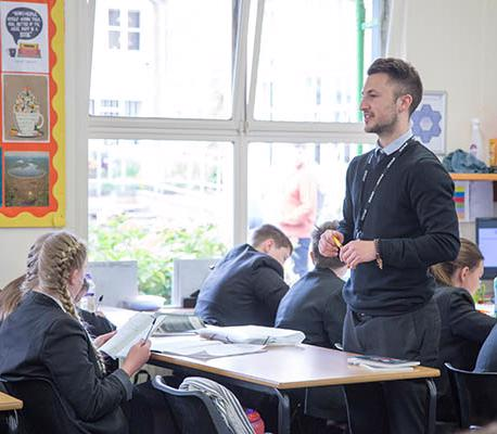 male teacher in a classroom