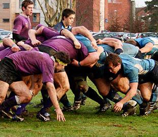 a rugby scrum with male players