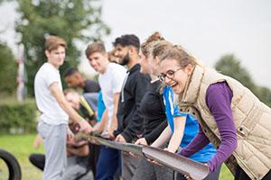 line of students holding a paper gutter