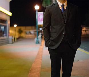 image of a suited man from the neck down